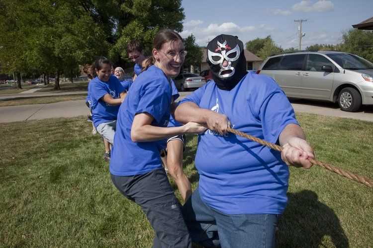 Douglas Count Dental Clinic staffers Shawna Huffman, left, and Ray Munzo, in mask, pulled for a tug-of-war win on Thursday, Aug. 9, 2012, to raise awareness about Kansas Primary Health Safety Net Clinic Week. They took on the staff at Health Care Access.
