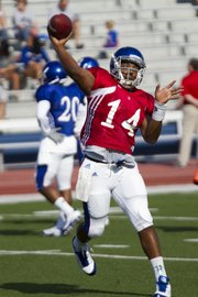 Kansas quarterback Michael Cummings makes a pass during a passing drill at the Fan Appreciation Day open practice Saturday, Aug. 11, 2012, at Memorial Stadium.