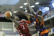 Kansas University's Anrio Adams, left,  tries to score against AMW Team France's Joseph Georgi during an exhibition match as part of Euro Jam Paris 2012, Sunday, August 12, 2012, at the Coubertin stadium in Paris.