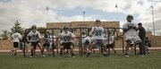 Free State football players work on their stances during the first day of practice on Monday, Aug. 13, 2012, at FSHS.