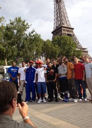 Kansas coach Bill Self takes an iPhone picture of his team in front of the Eiffel Tower before a Seine River dinner cruise on Monday, Aug. 13, 2012, in Paris.