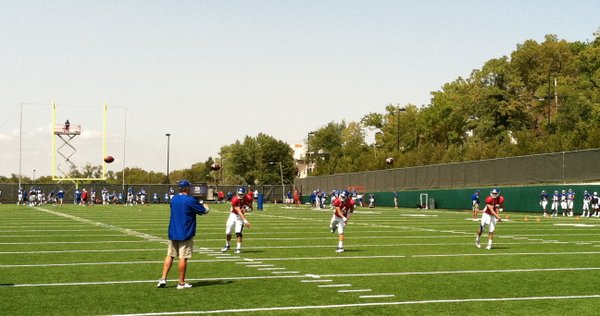 KU QBs (from left) Dayne Crist, Turner Baty and Blake Jablonski warm-up together during Tuesday's practice.