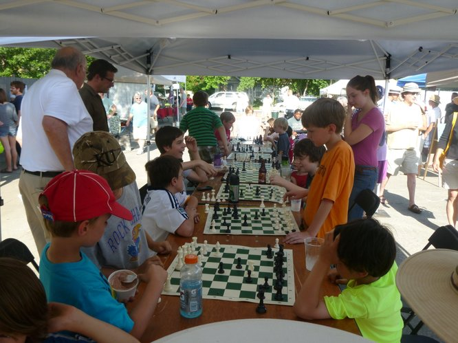Cordley Elementary School Chess Club Commences Play at Cottin's Hardware Farmers Market.