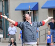 Sword swallower Thom Sellectomy demonstrates his trade at the 2011 Lawrence Busker Festival. Thom Sellectomy is scheduled to perform again at this year's festival.