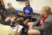 Kansas University volleyball players Caroline Jarmoc, left, Tayler Tolefree and Morgan Boub talk with media members during a fall sports media day at Allen Fieldhouse, Thursday, Aug. 16, 2012.