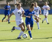 UC Santa Barbara's Taylor Gehring, left, and Kansas' Whitney Berry (7) jostle for position as the two attempt to gain control of the ball during their soccer match Friday, August 17, 2012 at KU.