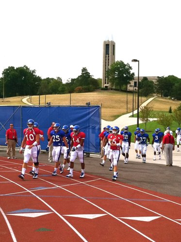 KU quarterback Dayne Crist (10) leads his group onto the field during Saturday morning's walk-through.