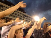 "Kansas University students ""wave the wheat"" at KU Traditions Night, Saturday in Memorial Stadium."