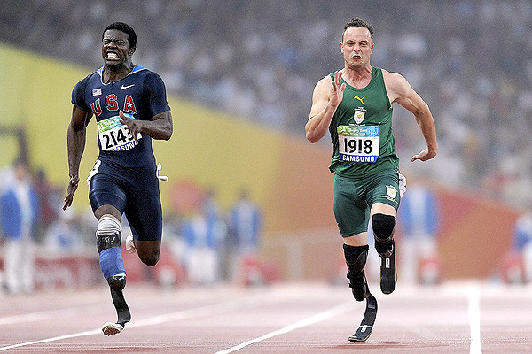 "Jerome Singleton Jr. (left) and Oscar Pistorius battle for the title of ""World's Fastest Amputee"" at The 2011 World Championship in New Zealand. Photo by Peter Parks, Getty Images."