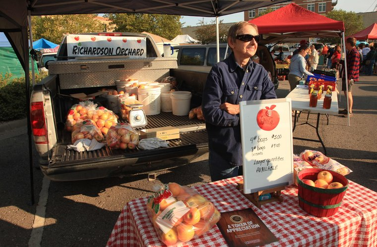 Clara Richardson waits for the next apple customer at the Lawrence Farmers market on a busy Saturday.