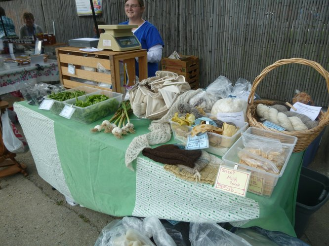 Pinwheel Farm offers fresh produce and hand spun local wool at Cottin's Hardware Farmers Market.