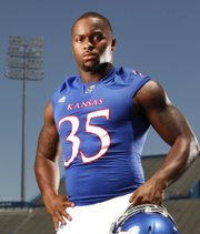 In this photo of Kansas defensive end Toben Opurum, photographer Nick Krug used two lights — a key light and backlight — to help separate subject from background.