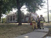 Firefighters respond to a reported fire at the Sigma Chi fraternity house, 1439 Tenn.