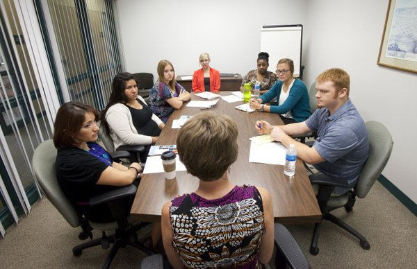 Lawrence-Douglas County Health Department interns attend a meeting with Kim Ens, director of clinic services, front, clinic assistant Frendida Zamora, left, and Americorps member, Wendy Particio-Ortiz, second from left, during an introductory meeting at the health department, Thursday, Aug. 23, 2012. The interns pictured are from right, Steven Mason, Kansas University, Bonnie Erickson, University of Wisconsin-Lacrosse, Crystan Vaughn, Stephanie Dawson and Alicia Erickson, all from KU.