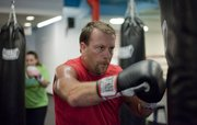 Craig Eddis participates in a boxing fitness class at Punch Boxing and Fitness, 4931 W. 6th St. Eddis attributes the class to helping him lose more than 20 pounds.