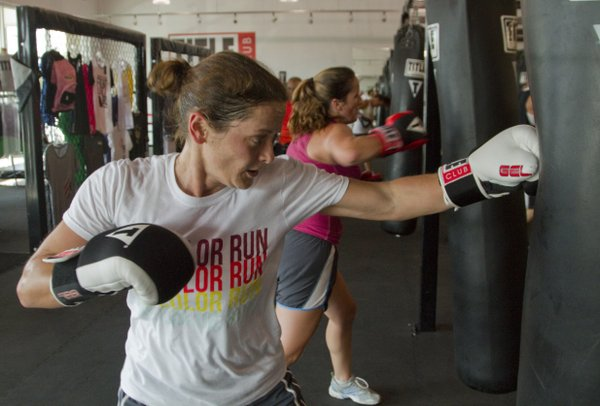 Shelly Sheets of Pomona throws a punch during a kickboxing class at Title Boxing Club, 1520 Wakarusa Drive.