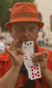 Producing a deck of cards from his mouth Daniel Jackson, of Kansas City Kan., was one of the early acts during Friday's Buskerfest in downtown Lawrence.
