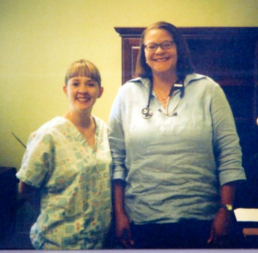 Kristi Garber, a licensed practical nurse, left, and Dr. Malati Harris, pose for a picture in July 2004 when Harris started working at Lawrence Family Medicine & Obstetrics. Since then, Harris has lost about 150 pounds through diet and exercise.