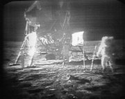 FILE - In this July 20, 1969 black-and-white file photo, taken from a television monitor, Apollo 11 astronaut Neil Armstrong, right, trudging across the surface of the moon. Edwin E. Aldrin is seen closer to the craft. NASA may not be going to the moon anytime soon and its space shuttles are about to be retired, but it could conceivably increase the number of agency jobs under a new reorganization, NASA's chief said Thursday.