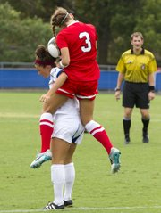 UNLV's Caitlin Allen (3) lands on the back of Kansas' Nicole Chrisopulos as they try to gain control of the ball during their soccer match Sunday, August 26, 2012, at the Jayhawk Soccer Complex.