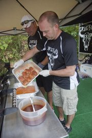 Truebud BBQ pitmaster Tim Grant, Tonganoxie, with help from Boyd Abts of Eudora, prepares chicken for the judges during the 2012 Smokin' on Oak barbecue competition in Bonner Springs.