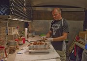 Truebud BBQ pitmaster Tim Grant, Tonganoxie, cleans up extra brisket after the last meat turn-in of Saturday's Smokin' on Oak barbecue competition in Bonner Springs. Truebud is one of the top barbecue teams in the country right now, hanging in the top 10 of the Kansas City Barbeque Society's Team of the Year points chase.