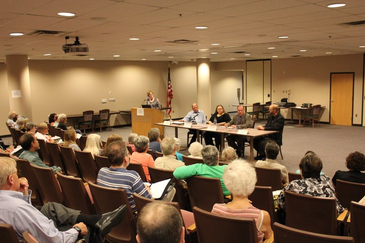 About 60 people attend a panel discussion Monday, Aug. 27, 2012, about Medicaid and the possibility that the state could opt to expand the program. Anna Lambertson, executive director of the Kansas Health Consumer Coalition, at podium, moderated the discussion inside Lawrence Memorial Hospital's auditorium. Serving on the panel, from left, are LMH President and CEO Gene Meyer, Jennifer Weishaar, an unemployed Lawrence resident, Scott Brunner, Kansas Health Institute senior analyst, and Heartland Community Health Center CEO Jon Stewart.