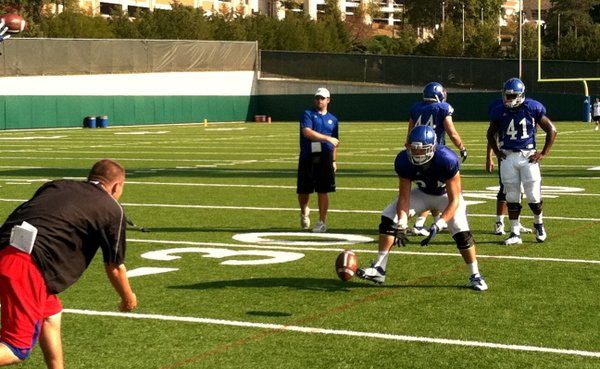 Tight ends coach Jeff Blasko and senior Mike Ragone work through a drill during the early part of Wednesday's practice.