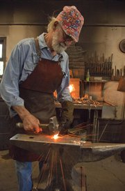 Walt Hull, who lives in Pleasant Grove south of Lawrence, has been a blacksmith for more than 15 years and creates fences, gates, tables and more from iron.