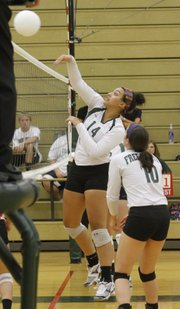 Kailee Dudley spikes early in the Free State Firebirds two set sweep of Lansing High School, Thursday night at LFSH.