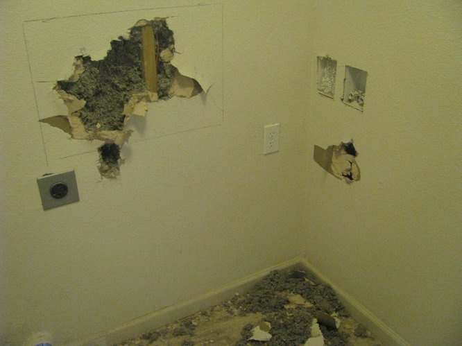 Damage done inside Lawrence Habitat's 80th home after a break in.