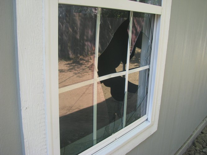 Broken window at Lawrence Habitat's 80th home, which is set to be dedicated on Saturday.