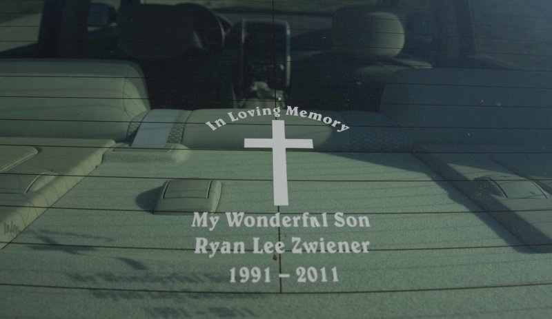 Lisa and Raymond Zwiener, of Lawrence, display a tribute to their son, Ryan, in the rear window of the family car. Ryan died by suicide at age 19 in December 2011 after a battle with depression. They openly talk about the suicide in hopes of preventing other deaths, but they also don't want Ryan to be remembered for how he died.