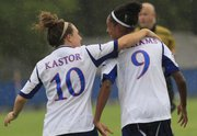 Kansas' Caroline Kastor (10) gives teammate Ashley Williams a pat on the back after Williams scored the first goal for KU against Creighton on Friday, Aug. 31, 2012, at Jayhawk Soccer Complex.