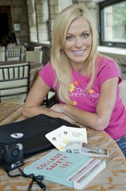 """The Safety Chick"" Kathleen Baty is author of ""College Safety 101,"" and she has become a personal safety expert and advocate after having a stalker for eight years. She is pictured with a college safety kit, available at her website, SafetyChick.com."