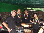 "Douglas Perry, Patrick Timmis, Bao-Tin Van Cong and Mai Tadokoro make up the per the percussion section for ""Die Blume von Hawaii"" at the Eutin Festival. Perry, Timmis and Tadokoro are Kansas University students."