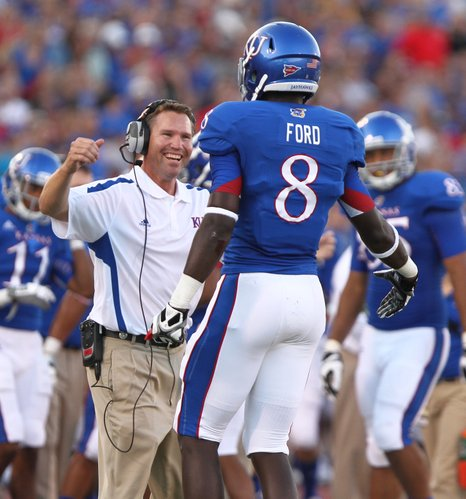 Kansas special teams coach Clint Bowen looks to hug receiver Josh Ford after Ford's blocked punt by South Dakota State in the second quarter, Saturday, September 1, 2012 at Memorial Stadium.