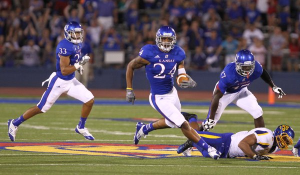 Kansas safety Bradley McDougald takes off up the field after an interception in the third quarter against South Dakota State, Saturday, September 1, 2012 at Memorial Stadium.