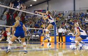 Kansas Brianne Riley celebrates a point during Kansas match against Arkansas State Saturday, Sept. 1, 2012 at the Horejsi Center. Kansas won the match three sets to one.