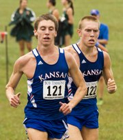 Kansas' Josh Baden (121) and Reid Buchanan (122) approach the finish line during the men's 6K race at the Bob Timmons Classic, held Saturday, Sept. 1, 2012, at Rim Rock farm.