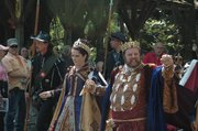 The king and queen of the festival, who this year are King Henry VIII and his sixth wife, Catherine Parr, walk through the village as part of the Royal Parade.