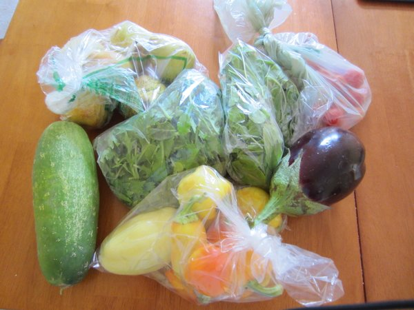 This week&#39;s goodies: pears, cucumber, peppers, arugula, spring mix, cherry tomatoes and eggplant.