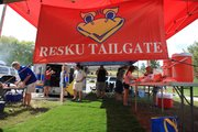 Tailgaters who came to Memorial Stadium in the Kanbulance, an ambulance decked out in crimson and blue, bring an impressive set up and a serious attitude when it comes to cooking up grub before KU games.