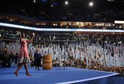 First lady Michelle Obama waves to delegates at the Democratic National Convention in Charlotte, N.C., on Tuesday.