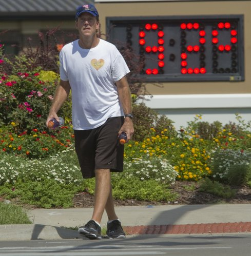 Despite the heat, Michael Travis, Lawrence, walks south on Wakarusa Drive, Tuesday, Sept. 4, 2012, in preparation for a 26.2-mile walk on Sunday from Topeka to Lawrence. He is bringing the annual Boston Marathon  Jimmy Fund Walk to Lawrence in honor of his brother, Mark, who is a cancer survivor, and the hundreds of thousands of others affected by cancer.