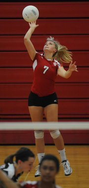 Lawrence High's Brealynn May serves against Shawnee Mission West on Thursday, Sept. 6, 2012, at LHS.