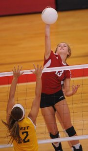 Lawrence's Caroline Dykes gets up for a spike against Shawnee Mission West on Thursday, Sept. 7, 2012, at LHS.