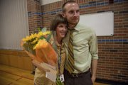 Kennedy Elementary Kindergarten teacher Lauren Mitchell gets a hug from her husband after she received the Horizon Award award from the Lawrence School system on Thursday Sept 6, 2012.