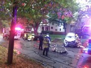 Crews work the scene of a head-on collision on the 900 block of Maine Street.