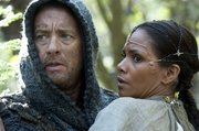 "This film image released by Warner Bros. Pictures shows Tom Hanks as Zachry and Halle Berry as Meronym in a scene from ""Cloud Atlas,"" an epic spanning centuries and genres. )"